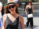 Myleene Klass nails sophisticated chic in a black silk top and a fedora