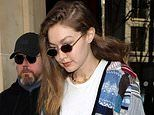 Gigi Hadid looks stylish in a patchwork cardigan as she and sister Bella head outfor PFW