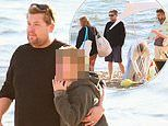 James Corden hugs his son Max, 9, during a mask-free beach picnic with his family and friends in LA