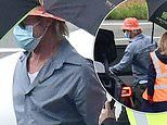 Brad Pitt, 56, braves the rain in Paris as he leaves hotel without girlfriend Nicole Poturalski, 27