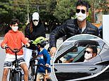 Simon Cowell enjoys family bike ride with Lauren Silverman and their son Eric, six, in Malibu