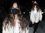 Olivia Munn puts on a leggy display in denim shorts and knee-high boots for dinner date in LA