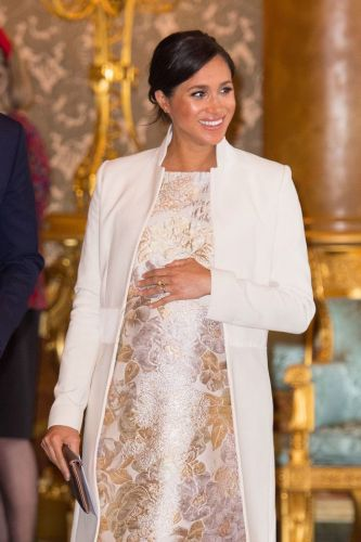Meghan Markle refuses to wear maternity clothes because she thinks they're 'frumpy', royal fashion expert claims