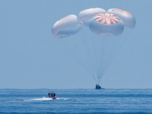 New video shows SpaceX's astronaut crew plummeting through Earth's atmosphere, floating under parachutes, and landing in the ocean