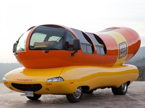 Oscar Mayer is paying 12 people to spend a year traveling in its giant hot-dog cars