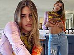 Amelia Gray Hamlin puts her tight tummy on display in '90s chic crop top as she poses in mirror