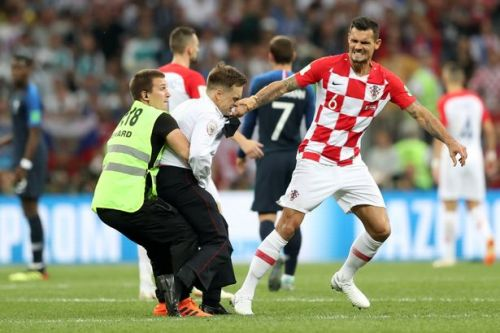 Pussy Riot pitch invader tackled by Dejan Lovren as protesters halt World Cup Final