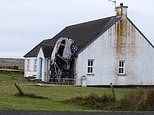 Three people left with serious injuries after their car crashes into a house and bursts into flames