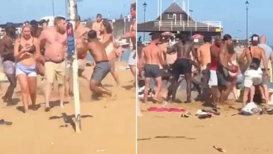 Huge fight breaks out on crowded beach involving at least 15 men