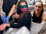 Brooke Shields flashes a thumbs-up as she has a tattoo removed from her wrist by laser