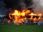 Huge blaze engulfs high school as more than 80 firefighters battle flames through the night