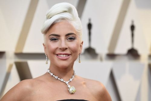 Lady Gaga says her iconic 2019 Oscars Tiffany necklace was taken off her by security after she partied with Madonna
