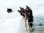 Daredevil kids risk their lives surfing massive swell at South Curl Curl