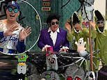 Elton John plays the piano dressed as Elvis as sons dance around in crocodile costumes