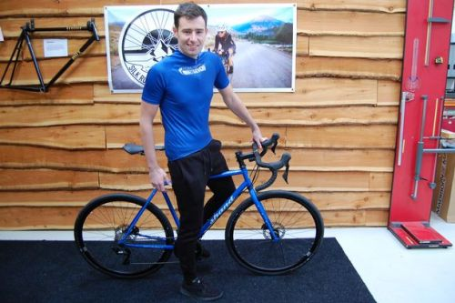 Charity cyclist is delighted with new bike to help him complete round-the-world challenge