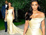 Kim Kardashian exudes old Hollywood style in $9300 vintage WEDDING DRESS for Diddy's 50th birthday