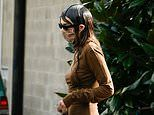 Kendall Jenner sports DRENCHED hair look as she steps out during Milan Fashion Week