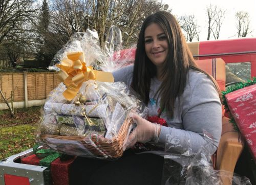 Lottery winners team up to deliver luxury Christmas hampers to carers