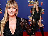 Heidi Klum shows serious skin in a slinky laser cut look at the MTV Movie & TV Awards: Unscripted