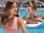 Chloe Lewis showcases her enviable post-baby body in a dusty pink belted swimsuit during Ibiza break