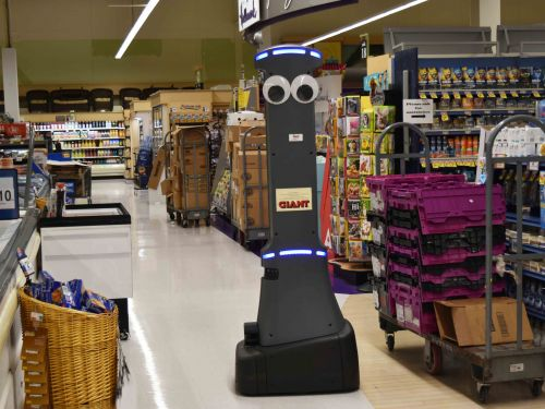 An adorable grocery robot is celebrating his first birthday with a party in hundreds of stores - and it reveals a dystopian truth about the future of retail
