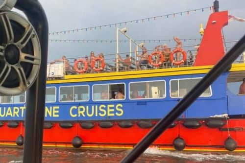 Couple's anniversary dinner interrupted when nudist cruise pulls up beside them
