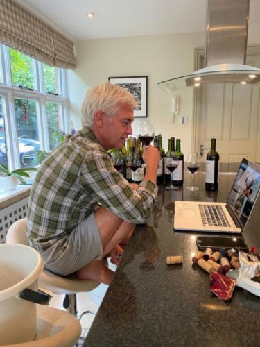 Inside Phillip Schofield's country house as he sinks wine at marble breakfast bar and fries fish in the luxury kitchen