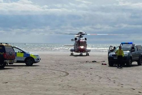Boy, 6, swept out to sea on inflatable and 'found facedown in water' by builder
