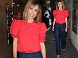 Alex Jones looks radiant in red frilled blouse and high-waist denim jeans