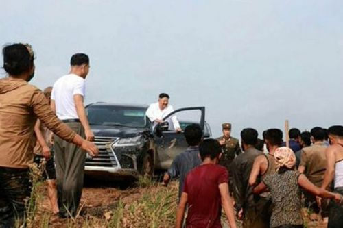 Kim Jong-un rolls up to village devastated by floods in luxury SUV