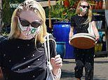 Dakota Fanning sports an all black patterned ensemble for an outing to a plant nursery