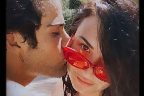Demi Lovato's hunky new man 'loves her flaws and all' as she posts loved up snap
