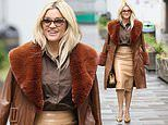 Ashley Roberts shows off her sartorial style in a tan pencil skirt and leather trench coat