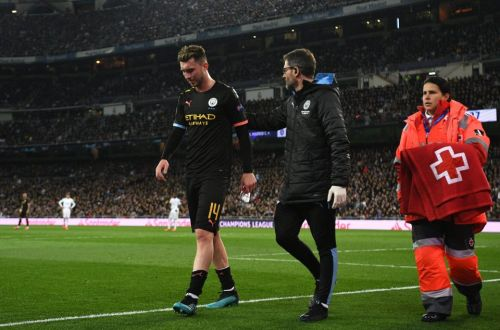 Man City face Carabao Cup final injury crisis as Laporte limps off against Real Madrid