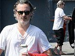 Joaquin Phoenix steps out to his car barefoot after taking a karate class in Beverly Hills