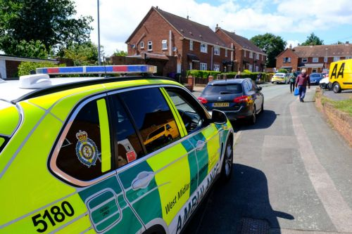 Man charged with stabbing two paramedics called to his house