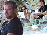 Matt Damon hits the beach in Malibu to go over some script pages with his wife Luciana Barroso