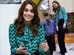 Kate Middleton cuts a stylish figure in jazzy electric blue blouse and wide-leg trousers