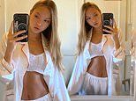 Kate Moss' daughter Lila flaunts her midriff in a knitted crop top and silk pyjamas