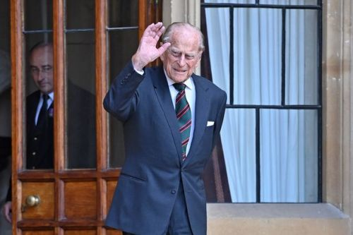 Prince Philip smiles as he breaks retirement for first engagement in a year