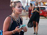 Rita Ora looks stylish in a black beach dress and £3,550 blue Chanel rucksack