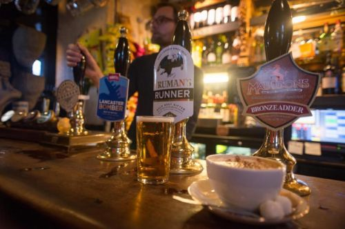 Millions of lonely Brits desperate to go to the pub more often - but don't have anyone to go with