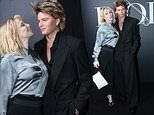 Jordan Barrett cuts a stylish figure as he cosies up to Courtney Love at Dior fashion show in Paris