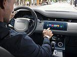 Car infotainment systems and mobile phones keeping death rate on Britain's roads unchanged, warn DfT