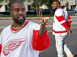 Kanye West sports a hockey jersey and gold chains as he leaves his office in Calabasas