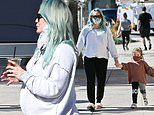Hilary Duff covers growing baby bump in grey sweatshirt as she takes daughter Banks for ice cream