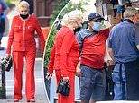 Ivana Trump models a bright red suit as she gets food from a New York street cart