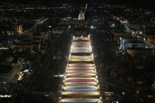 A stunning art installation of nearly 200,000 US flags has filled the National Mall, representing Americans who can't attend Biden's inauguration