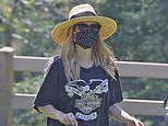 Pregnant Emma Roberts covers up her baby bump in a oversized black Harley Davidson T-shirt