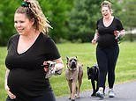 Teen Mom 2 star Kailyn Lowry cradles her growing bump in a tight black tee